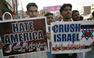 Pakistani Shi'ite Muslims hold placards during an al-Quds day rally in Multan